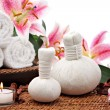 Spa massage setting with towels and flowers - 图库照片