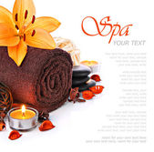 Spa massage border with towel and orange lily flower — Stock Photo
