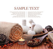 Spa massage border background with towel and compress balls — Stock Photo