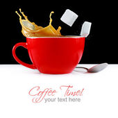 Cup of coffee with splash and sugar cubes — Stock Photo