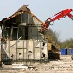 Excavator demolishing a building — Stock Photo #9616667