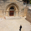Christian priest walking to the ancient Jerusalem church — Stock Photo