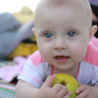 Baby with big, blue eyes - Stockfoto