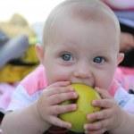 Little Baby Child Sucking Apple — Stock Photo
