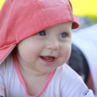 Child in pink hat — Stok fotoğraf