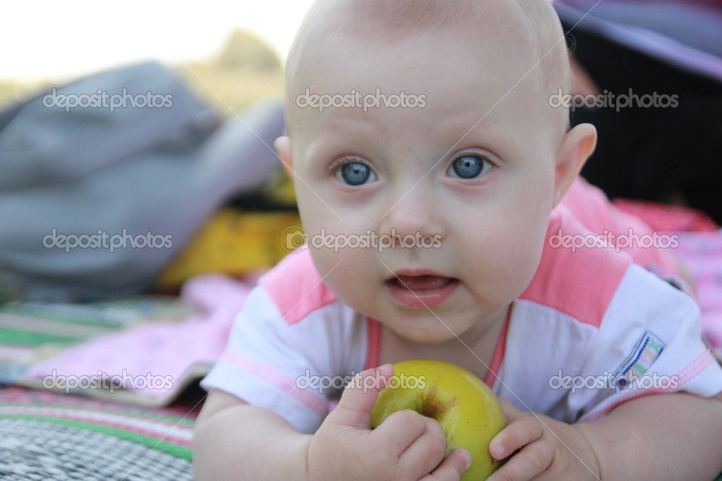 Close-up of a happy baby with big, blue eyes  Stock Photo #12194615