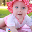 Baby girl in pink summer dress and hat — Stock Photo