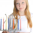 Hanukkah card - Young Jewish girl with the candles — Stock Photo #13346465
