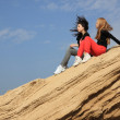 2 girls on a rock — Stock Photo