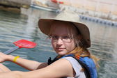 Beautiful blonde girl on the kayak — Stock Photo