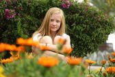 Cute blonde girl at the wildflowers — Stock Photo