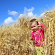 Little girl on a wheat field — Stock Photo