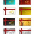 Gift cards with a ribbon and bow — Stock Photo