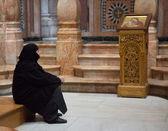 Nun in the church — Stock Photo
