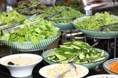 Healthy fresh green salads in the all inclusive restaurant — Stock Photo