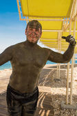 Funny picture - man treated with Dead Sea mud — Stock Photo