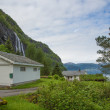 Houses in Norway near waterfall — Stock Photo #48831435