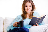 Attractive Woman Relaxing With A Book And Coffee — Stock Photo