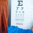 A doctor watching a test for eye examination — Stock Photo