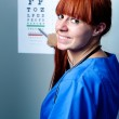 Female oculist doctor examining patient — Stock Photo #17386221