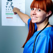 Stock Photo: Female oculist doctor examining patient