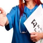 Female doctor giving hand for handshake — Stock Photo #17386579