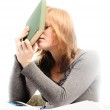 Stressed student revising for an exam - isolated on white backgr — Stock Photo