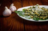 Pasta with spinach on a wooden table — Stock Photo