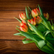 Tulips on rustic wooden table — Stock Photo #22366981