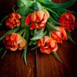 Tulips on rustic wooden table — Stock Photo #22367207