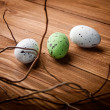 Stock Photo: Easter eggs on wooden plank