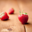 Fresh strawberries on a wooden background — Stock Photo