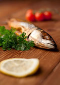 Smoked fish (mackerel), on board, selective focus — Stock Photo