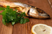 Smoked fish (mackerel), on board, selective focus — 图库照片