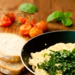 Stock Photo: Scrambled eggs with chives and herbs and two slices of bread