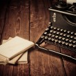 Vintage typewriter and old books, touch-up in retro style — Stock Photo #27295579