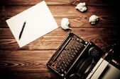 Vintage typewriter and a blank sheet of paper, retouching retro — Stock Photo