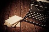 Vintage typewriter and old books, touch-up in retro style — Stock Photo
