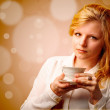 Attractive woman with a cup of coffee — Stock Photo #27496993