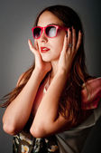 Fashion shoot of beauty young girl with sunglasses — Stock Photo