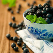 Bowl of blueberries on a wooden background — Stock Photo