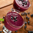 Glass of fresh blueberry smoothie with blueberries — Stock Photo #28789747