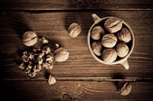 Walnuts on wooden boards — Stockfoto