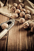 Walnuts on wooden boards — Stock Photo