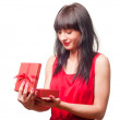 Beautiful brunette opens gift — Stock Photo