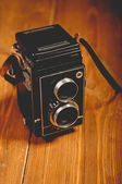 Vintage camera on wooden background — Stock Photo