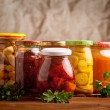 Composition with jars of pickled vegetables. Marinated food. — Stock Photo #40085677