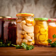 Stock Photo: Composition with jars of pickled vegetables. Marinated food.