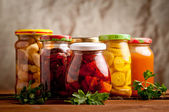 Composition with jars of pickled vegetables. Marinated food. — Stock Photo