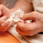 Women's hands crocheting — Stock Photo #40702965